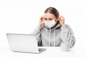 woman deleting files with mask on