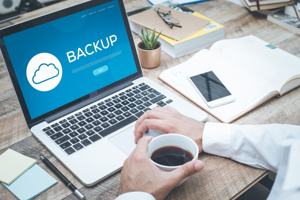 Backup data to the cloud on your laptop, work from home securely concept