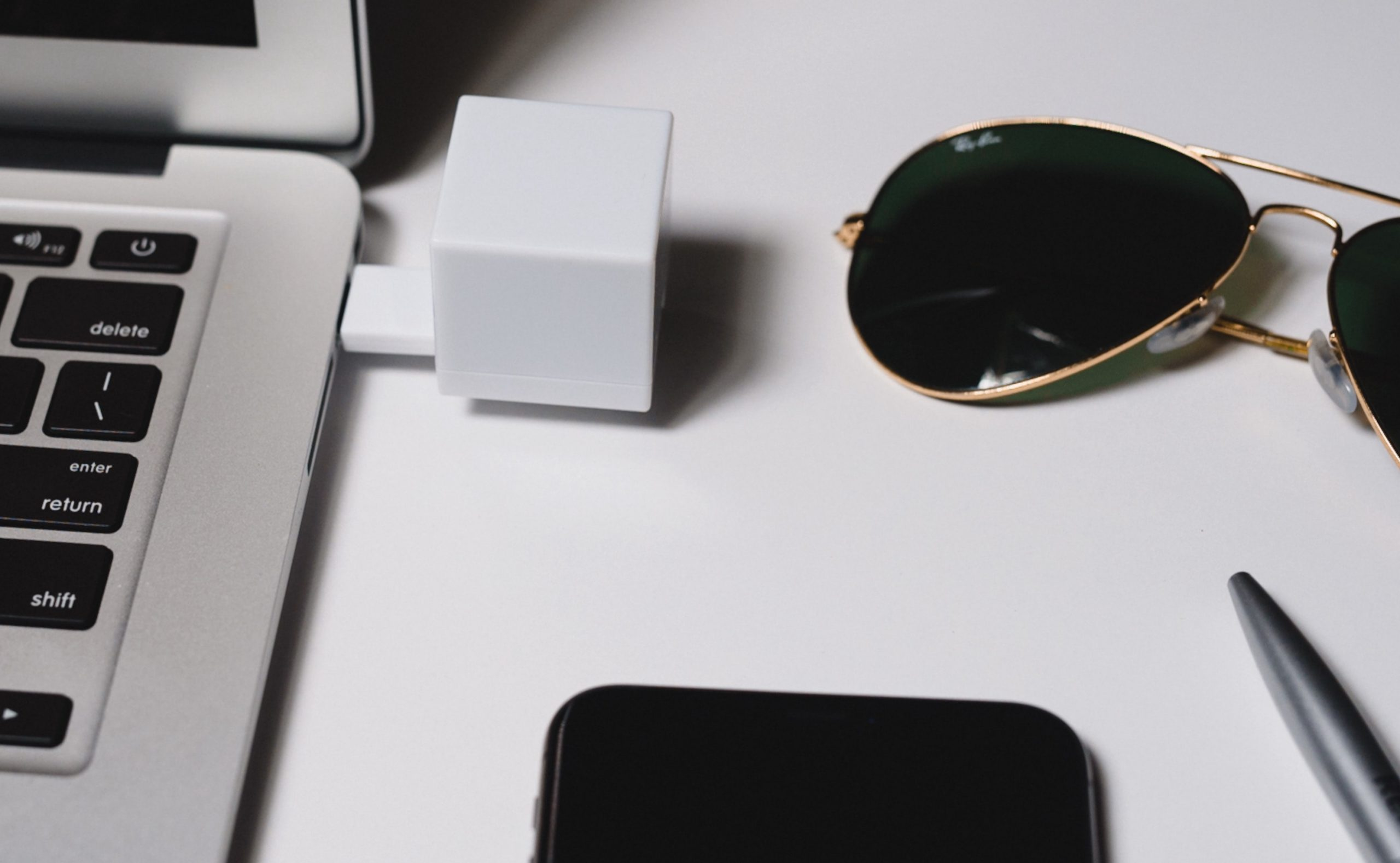 shred cube ready to delete files next to sunglasses