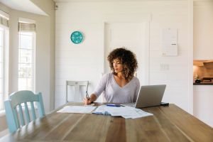 Young woman working from home, remote workforce concept
