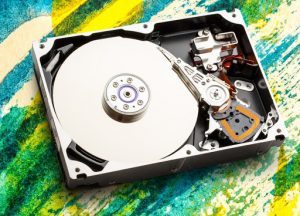 Hard drive disk used in a disk defrag, what does a disk defrag do concept