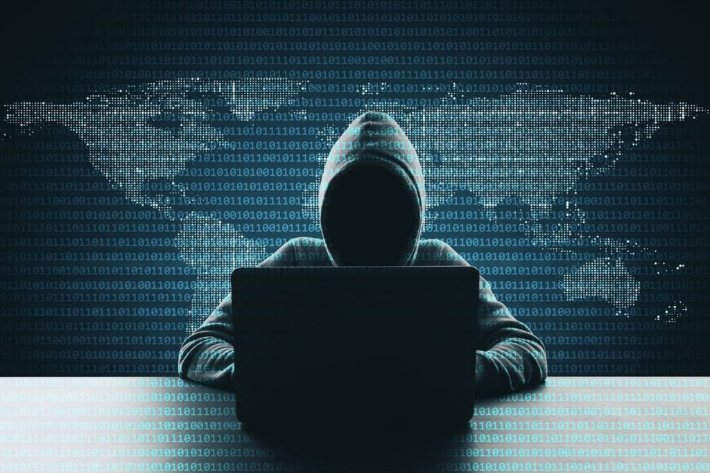 Hacker using phishing techniques on a computer, protect your data concept