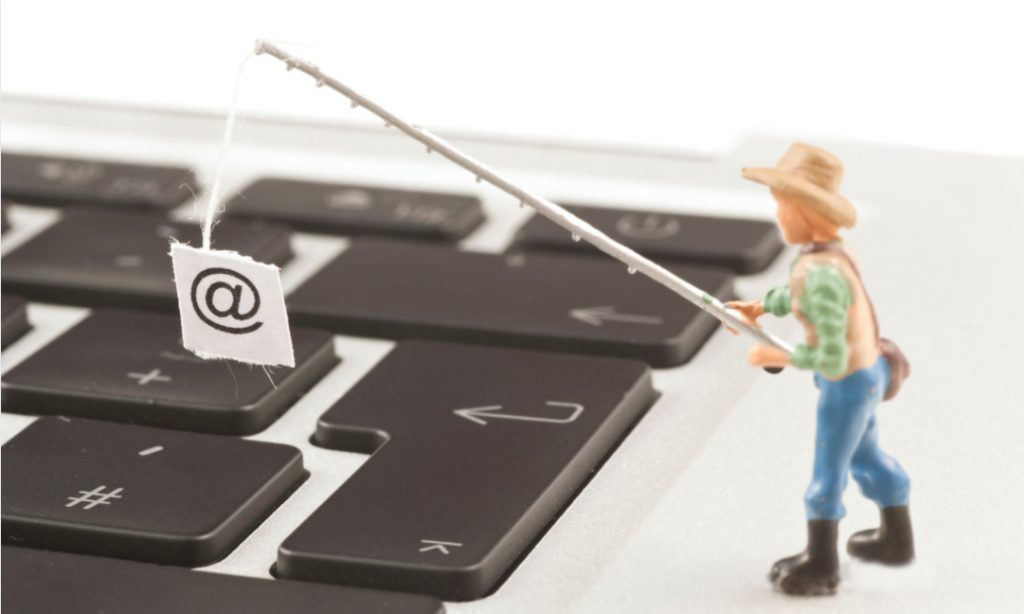 Person with fishing pole over keyboard
