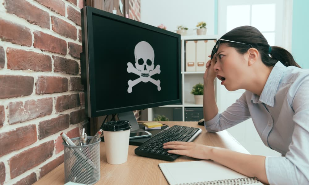 Woman looking at computer with malware