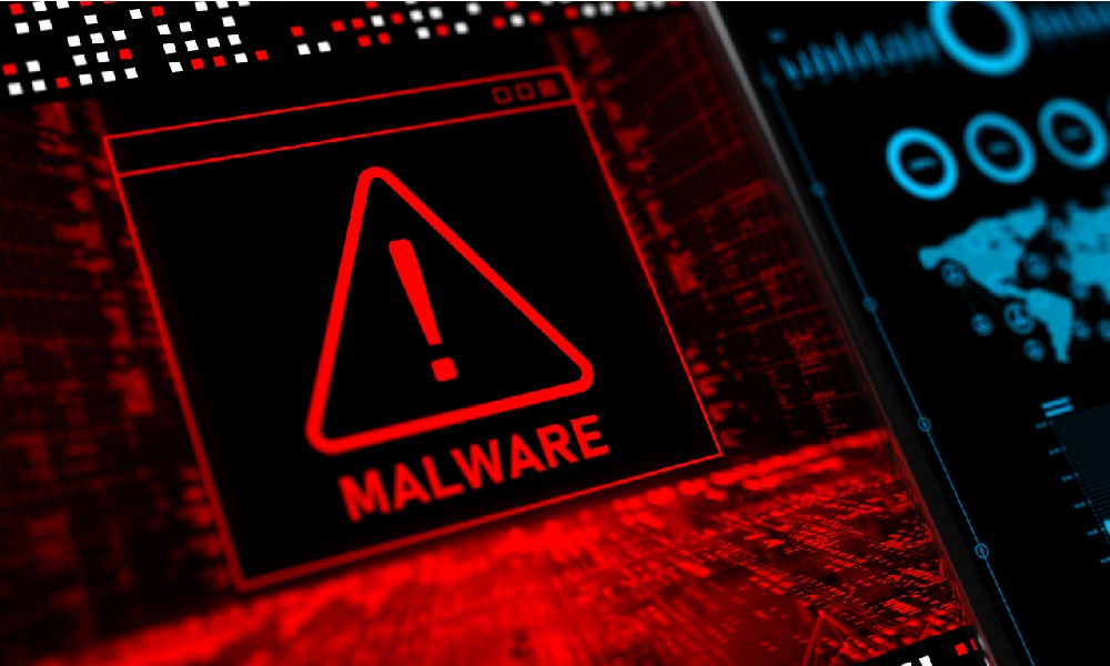 A red warning on a computer screen that consists of an exclamation point inside a triangle, alerting to a malware infection