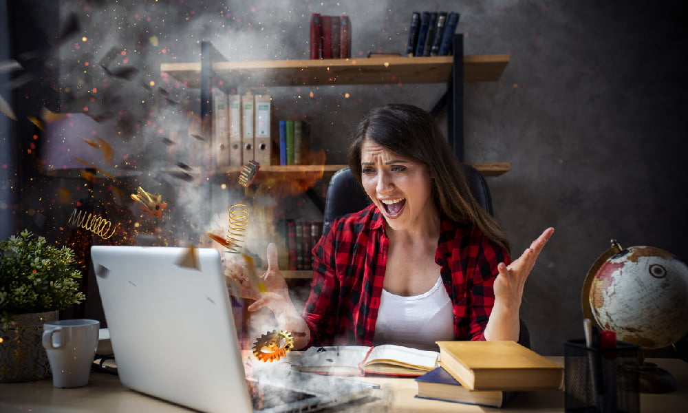 A woman deals with a laptop overheating and having a cartoonish explosion due to poor ventilation, dirty fans, and too many undeleted files.