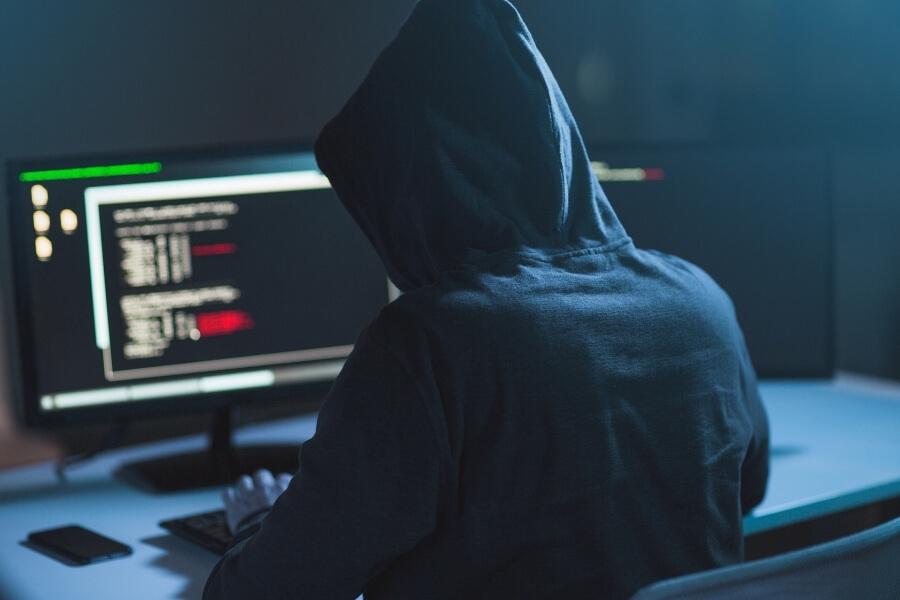 hacker inserting virus onto computer