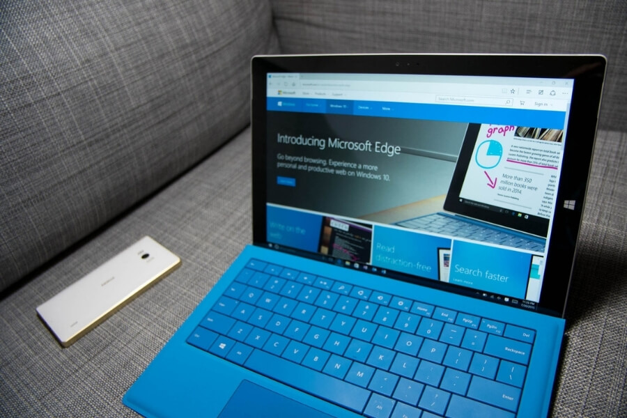 microsoft edge browser displayed on a blue microsoft surface computer