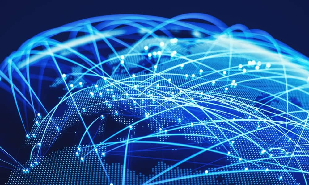 illustration of data transfer around the globe, representing tips on how to lower ping
