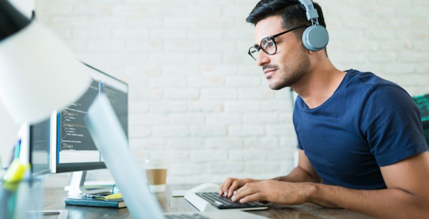 Young man working remotely with software, remote work policy concept