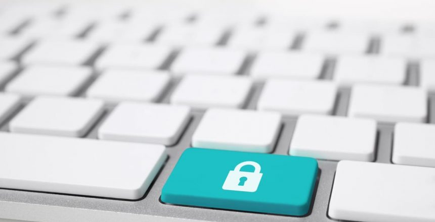 Security lock on keyboard, file shredder and cyber security concept